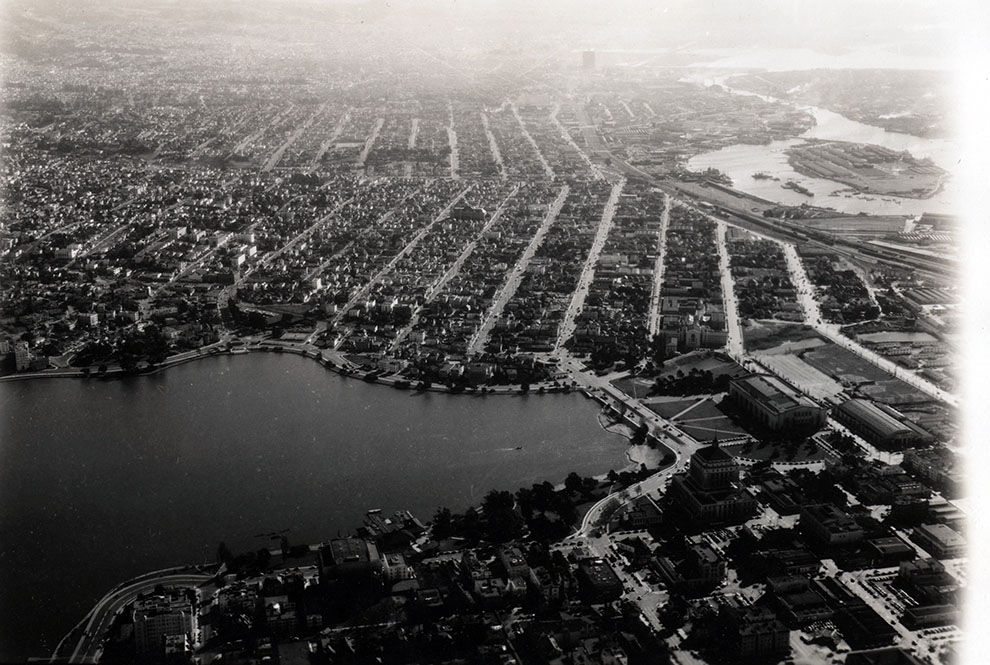 Black and white photograph of aerial view of east area of Lake Merritt, circa 1940s